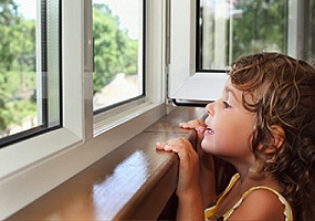 girl looking through casement upvc windows